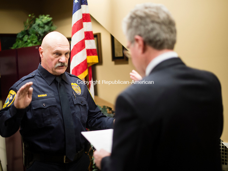 MIDDLEBURY, CT- 11 January 2015-011116EC01-    Fran Dabbo gets sworn into the Middlebury Police Chief position by Kenneth Heidkamp, the Chairman of the Police Commission. The current chief, James Viadero, is leaving for a chief's job in Newtown. The ceremony happened Monday night at Middlebury Town Hall. Erin Covey Republican-American