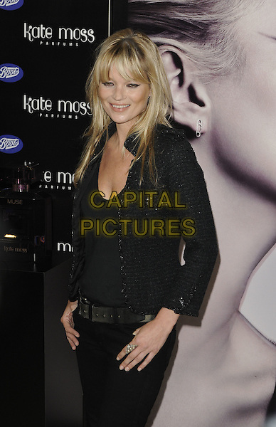 KATE MOSS.Kate Moss launches her new fragrance for women - 'Vintage Muse', Boots, Oxford Street, London, England..26th November 2010.half length fringe bangs hair black jeans denim tweed jacket top belt.CAP/CAN.©Can Nguyen/Capital Pictures.
