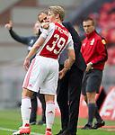 Nederland, Amsterdam, 21 juli 2012.Seizoen 2012/2013.Ajax-Celtic .Frank de Boer, trainer-coach van Ajax geeft aanwijzingen aan Viktor Fischer van Ajax