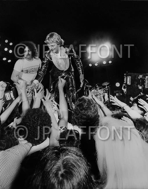 Juan Les Pins, France. July 26th, 1977. Claude Francois meets with the audience at the end of a concert in Juan Les Pins, southern France.