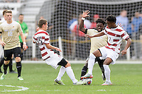 Houston, TX - Friday December 11, 2016: Ema Twumasi (22) of the Wake Forest Demon Deacons battles for the ball with Jared Gilbey (15) and Bryce Marion (7) of the Stanford Cardinal at the NCAA Men's Soccer Finals at BBVA Compass Stadium in Houston Texas.