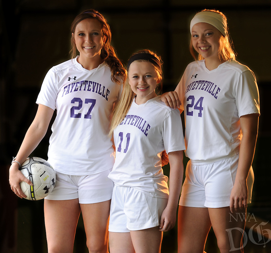NWA Democrat-Gazette/ANDY SHUPE - Ellie Breden (left), Abbie Sikes and Falon Hanson have provided leadership for the Fayetteville Lady Bulldogs soccer team this season. Tuesday, April 28, 2015.