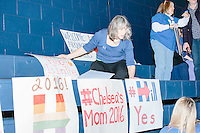 Mary Wilson, of Mont Vernon,NH, puts up hand-written campaign signs before former Secretary of State and Democratic presidential candidate Hillary Rodham Clinton speaks at a rally at Nashua Community College in Nashua, New Hampshire, on Tues. Feb. 2, 2016. Wilson said she did not make the signs.  Former president Bill Clinton also spoke at the event. The day before, Hillary Clinton won the Iowa caucus by a small margin over Bernie Sanders.