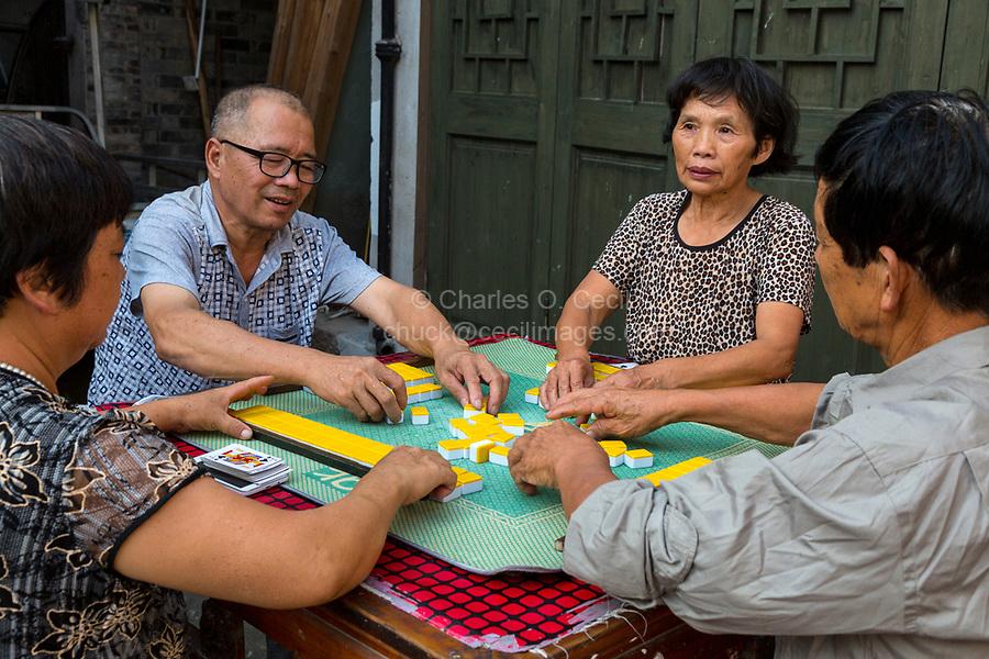 Cangpo, Zhejiang, China.  Local Residents Playing Mahjong.