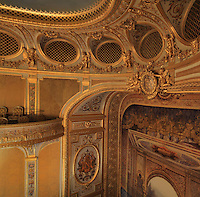 "High angle view showing a fragment of the ceiling, the grated boxes (loges grillées) located at the Gods or Paradise (paradis or poulailler in French), the first balcony and the Frons scaenae (stage wall) with trompe-l'oeil painting, Theatre Imperial Napoleon III de Fontainebleau (Fontainebleau Theatre Napoleon III), 1853-1856, by Hector Lefuel, Fontainebleau, Seine-et-Marne, France. Restoration of the theatre began in Spring 2013 thanks to an agreement between the Emirate of Abu Dhabi and the French Governement dedicating 5 M€ to the restoration.  In recognition of the sponsorship by the Emirate of Abu Dhabi, French Governement decided to rename the theatre as ""Theatre Cheikh Khalifa bin Zayed Al Nahyan"" (Cheikh Khalifa bin Zayed Al Nahyan Theatre). The achievement of the first stage of renovation has allowed the opening of the theatre to the public on May 3, 2014. Picture by Manuel Cohen"