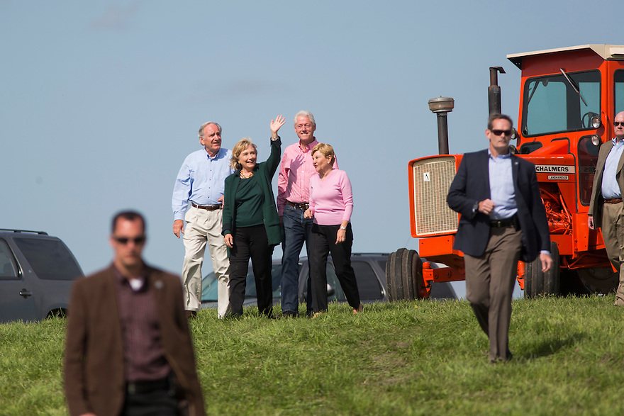 Hillary and Bill Clinton arrive with Iowa Senator Tom Harken at his annual Steak Fry in Indianola,  Iowa