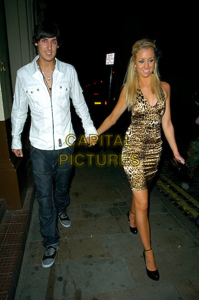 MIKEY GREEN & GRACE ADAMS SHORT.The Devaux Burlesque Party, Jewel Maiden Lane, London, England..September 11th, 2007.Big Brother 7 full length jeans denim white jacket leopard print dress silver clutch purse couple holding hands.CAP/CAN.©Can Nguyen/Capital Pictures