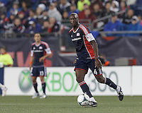 New England Revolution midfielder Kalifa Cisse (4) passes the ball. In a Major League Soccer (MLS) match, the New England Revolution (blue) tied New York Red Bulls (white), 1-1, at Gillette Stadium on May 11, 2013.