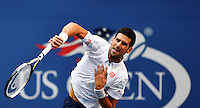 NEW YORK, USA - SEPT 09, Novak Djokovic of Serbia serves to Gael Monfils of France during their Men's Singles Semifinal Match of the 2016 US Open at the USTA Billie Jean King National Tennis Center on September 9, 2016 in New York.  photo by VIEWpress