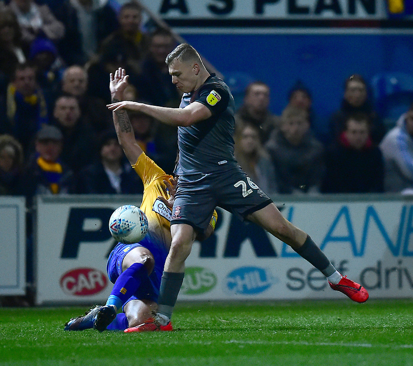 Lincoln City's Harry Anderson battles with  Mansfield Town's Jacob Mellis<br /> <br /> Photographer Andrew Vaughan/CameraSport<br /> <br /> The EFL Sky Bet League Two - Mansfield Town v Lincoln City - Monday 18th March 2019 - Field Mill - Mansfield<br /> <br /> World Copyright © 2019 CameraSport. All rights reserved. 43 Linden Ave. Countesthorpe. Leicester. England. LE8 5PG - Tel: +44 (0) 116 277 4147 - admin@camerasport.com - www.camerasport.com