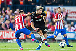 Kevin Kampl of Bayer 04 Leverkusen battles for the ball with Angel Correa of Atletico de Madrid during their 2016-17 UEFA Champions League Round of 16 second leg match between Atletico de Madrid and Bayer 04 Leverkusen at the Estadio Vicente Calderon on 15 March 2017 in Madrid, Spain. Photo by Diego Gonzalez Souto / Power Sport Images