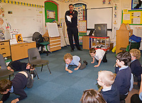 Firefighters on a visit to a local primary school. Children are being taught on what to do in case of fire at home. They are given a talk and shown a video. Warwickshire UK. This image may only be used to portray the subject in a positive manner..©shoutpictures.com..john@shoutpictures.com