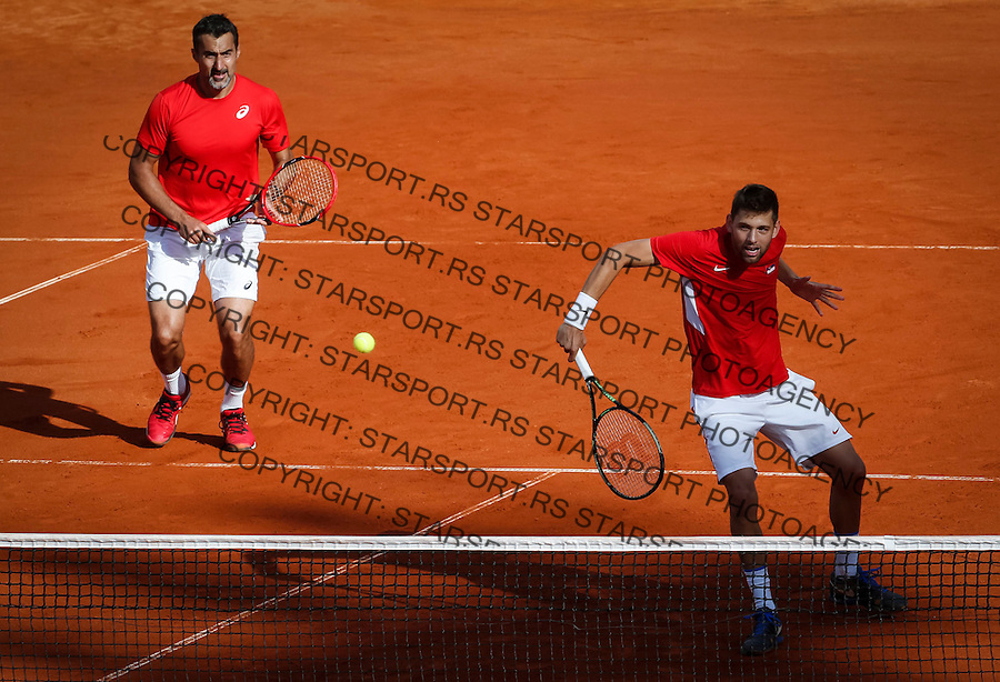 BELGRADE, SERBIA - JULY 16: Filip Krajinovic (R) and Nenad ZImonjic (L) of Serbia compete in the doubles match against Jamie Murray (L) and Dominic Inglot (R) of Great Britain during day two of the Davis Cup Quarter Final match between Serbia and Great Britain on Stadium Tasmajdan on July 16, 2016 in Belgrade, Serbia. (Photo by Srdjan Stevanovic/Getty Images)