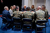 United States President Donald J. Trump, center left, and First Lady Melania Trump, center right, listen while speaking to Marines with John Kelly, White House chief of staff, left, at Marine Barracks in Washington, D.C., U.S, on Thursday, Nov. 15, 2018. President Trump and the First Lady are meeting with Marines who responded to a building fire at the Arthur Capper Public Housing complex on September 9, 2018. <br /> Credit: Andrew Harrer / Pool via CNP