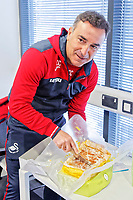Manager Carlos Carvalhal hands out traditional Portuguese Easter cake to members of the press during the Swansea City Training Session and Press Conference at The Fairwood Training Ground, Wales, UK. Thursday 29 March 2018