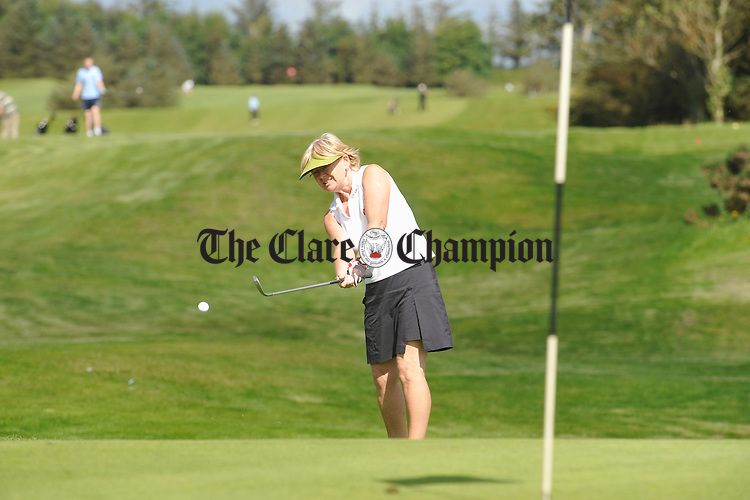 Gere O Byrne of Limerick makng the most of a short fine spell at Kilrush Golf Club recently. Photograph by John Kelly.