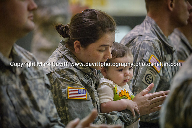 Samantha Mannis of Indianola and her son, 7-month-old CJ, <br /> attended the Deployment Farewell Ceremony for the Iowa National Guard 361st Medical Logistics Company. The ceremony was held Saturday at the Southeast Polk's Spring Creek Elementary gym. She is as a Bio Med Tech and attended in support of her fellow members. http://tinyurl.com/lfkjfrh