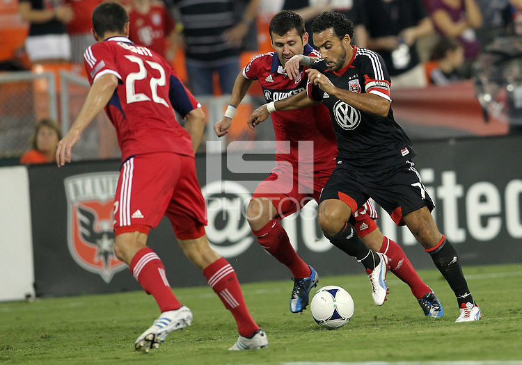 WASHINGTON, DC. - AUGUST 22, 2012:  Dwayne DeRosario (7) of DC United races away from  Gonzalo Segares (13) of the Chicago Fire during an MLS match at RFK Stadium, in Washington DC,  on August 22. United won 4-2.