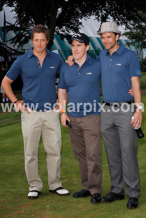 **ALL ROUND PICTURES FROM SOLARPIX.COM**.**WORLDWIDE SYNDICATION RIGHTS**.Celebrities attend The Leuka Mini golf Masters held at The Dukes Meadow Golf Club, Dan Mason Drive Uk..This pic: Hugh Grant, Rob Brydon and Dougray Scott..JOB REF: 11690      LNJ     DATE: 16.07.2010.**MUST CREDIT SOLARPIX.COM OR DOUBLE FEE WILL BE CHARGED**.**MUST NOTIFY SOLARPIX OF ONLINE USAGE**.**CALL US ON: +34 952 811 768 or LOW RATE FROM UK 0844 617 7637**