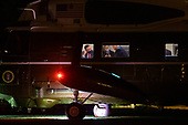 United States President Donald J. Trump confers with staff aboard Marine One after landing on the South Lawn of the White House in Washington, DC, USA, 18 September 2020. President Trump returned from Minnesota where he delivered remarks at a Great American Comeback event.<br /> Credit: Shawn Thew / Pool via CNP