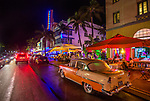 Old cars sit along the South Beach hotel and bar district near downtown Miami, Florida
