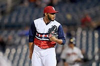 Syracuse Chiefs relief pitcher Jimmy Cordero (20) looks in for the sign during a game against the Scranton/Wilkes-Barre RailRiders on June 14, 2018 at NBT Bank Stadium in Syracuse, New York.  Scranton/Wilkes-Barre defeated Syracuse 9-5.  (Mike Janes/Four Seam Images)