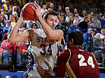 BROOKINGS, SD - JANUARY 31:  Cody Larson #34 from South Dakota State University looks to make a move against Christian Mackey #24 from Denver in the first half of their game Saturday afternoon at Frost Arena in Brookings. (Photo by Dave Eggen/Inertia)