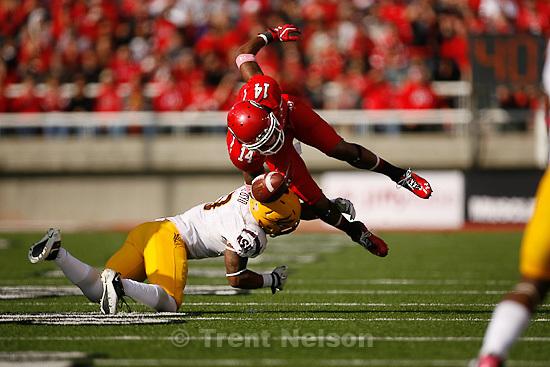 Trent Nelson  |  The Salt Lake Tribune.Utah receiver Reggie Dunn fumbles the ball as he's hit by Arizona State safety Clint Floyd in the second half, Utah vs. Arizona State, college football at Rice-Eccles Stadium in Salt Lake City, Utah, Saturday, October 8, 2011.