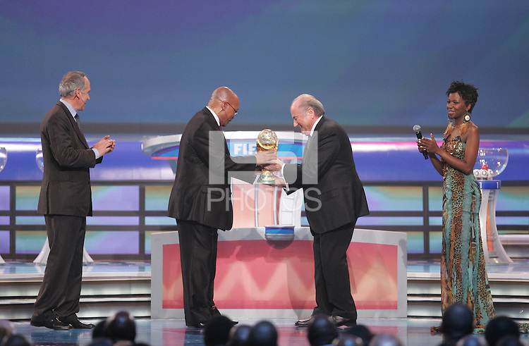South African President Jacob Zuma with FIFA president Joseph S Blatter with the World Cup during the FIFA Final Draw for the FIFA World Cup 2010 South Africa held at the Cape Town International Convention Centre (CTICC) on December 4, 2009.