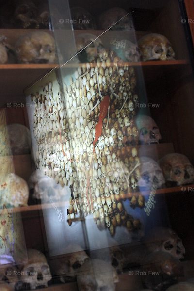 Until 2002, visitors could see the infamous map of Cambodia made with the skulls of people killed by the Khmer Rouge. Now the map has been removed on the grounds that it was too sensational, but a picture of it remains and the same skulls are displayed in a glass case in the museum.<br /> <br /> On 17th April 1975, after five years of civil war, Cambodia's capital Phnom Penh fell to the Khmer Rouge, who instigated a brutal reign of terror that would see the death of some 1.7 million Cambodians. In an attempt to create a self-sufficient agrarian paradise, cities were emptied, money and religion were banned and roughly a quarter of the population was worked and starved to death or executed. <br /> <br /> At the centre of this brutality was S-21, also known as Tuol Sleng, the Khmer Rouge prison located in the grounds of an old Phnom Penh school. Before the Vietnamese liberation of Phnom Penh on 7th January 1979, at least 14,000 people were tortured and executed here or at the nearby Choeung Ek killing field.