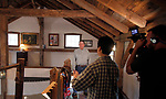 """ROXBURY, CT - 15 OCTOBER 2017 -101517JW07.jpg --  HGTV's """"You Live in What?"""" producer Kent Takano asks questions about the home of Roxbury resident Ed Cady as camera operator Dan Nugent films Sunday morning. Jonathan Wilcox Republican-American"""