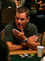 MATT DAMON.The Ante Up for Africa Celebrity Poker Tournament at the Rio Resort Hotel and Casino, Las Vegas, Nevada, USA..July 2nd, 2009.half length table bet betting chips cards grey gray hand mouth open t-shirt.CAP/ADM/MJT.© MJT/AdMedia/Capital Pictures