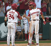 NWA Democrat-Gazette/J.T. WAMPLER Arkansas' Dominic Fletcher and Casey Opitz celebrate after scoring against Ole Miss Monday June 10, 2019 during the NCAA Fayetteville Super Regional at Baum-Walker Stadium in Fayetteville. Arkansas won 14-1 and will advance to the College World Series in Omaha.
