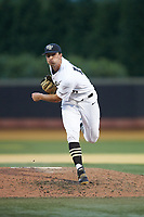 Wake Forest Demon Deacons relief pitcher Carter Bach (18) follows through on his delivery against the Davidson Wildcats at David F. Couch Ballpark on May 7, 2019 in  Winston-Salem, North Carolina. The Demon Deacons defeated the Wildcats 11-8. (Brian Westerholt/Four Seam Images)