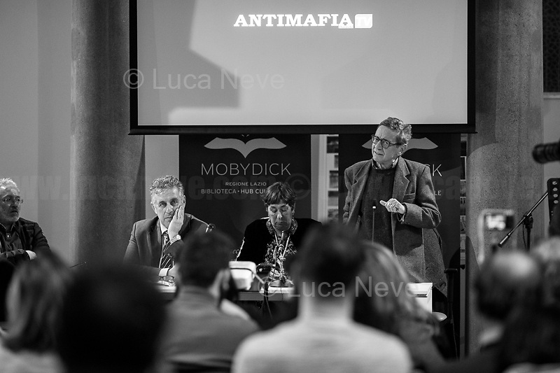 """(From L to R) Bongiovanni, Di Matteo, Resta, Lodato.<br /> <br /> Rome, 08/02/19. Moby Dick Library in Garbatella & Antimafia Duemila(2.) held the presentation of the book """"Il Patto Sporco"""" (The Dirty Pact. The Trial State-mafia in the Story [narrated] by his Protagonist, Chiarelettere,1.) hosted by the author of the book Saverio Lodato (Journalist & Author), Antonino 'Nino' Di Matteo (Protagonist of the book, Antimafia Magistrate of Palermo, member of the DNA - Antimafia & Antiterrorism National Directorate - who """"prosecuted the Italian State for conspiring with the Mafia in acts of murder & terror"""",3.4.5.6.) & Giorgio Bongiovanni (Editor of Antimafia Duemila). Chair of the event was Silvia Resta (Journalist & Author). Readers were: Bianca Nappi & Carlotta Natoli (both Actresses). From the back cover of the book: """"Let us ask ourselves why politics, institutions, culture, have needed the words of judges to finally begin to understand…A handful of magistrates and investigators have shown not to be afraid to prosecute the [Italian] State. Now others must do their part too"""" (Nino Di Matteo). """"In the pages of this book I wanted the magistrate, the man, the protagonist and the witness to speak about a trial destined to leave its mark"""" (Saverio Lodato). From the book online page: """"The attacks to Lima [politician], Falcone & Borsellino [Judges], the bombs in Milan, Florence, Rome, the murders of valiant police commissioners & officers of the carabinieri. The [Ita] State on its knees, its best men sacrificed. However, while the blood of the massacres was still running there were those who, precisely in the name of the State, dialogued and interacted with the enemy. The sentence of condemnation of Palermo [""""mafia-State negotiation"""" trial which is told in the book], against the opinion of many 'deniers', proved that the negotiation not only was there but did not avoid more blood. On the contrary, it provoked it""""(1.).<br /> Footnotes & links provided at 2nd & last page."""