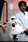 Seiko-chan, a mono-cycling humanoid robot from Murata Manufacturing Co.,  is demonstrated  in Japan.