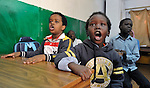 A refugee boy yells enthusiastically in class in a school operated by St. Andrew's Refugee Services in Cairo, Egypt. Located at St. Andrews United Church of Cairo, the program is supported by Church World Service.
