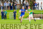 Stam O'Donoghue tries to turn the Mitchell defender Laurnece Bastible during their Intermediate Championship semi final in Killorglin on Saturday