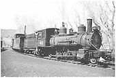 3/4 view of RGS 2-8-0 #42 at Durango with caboose #0404 and tender from D&amp;RGW #452.<br /> RGS  Durango, CO  3/1953