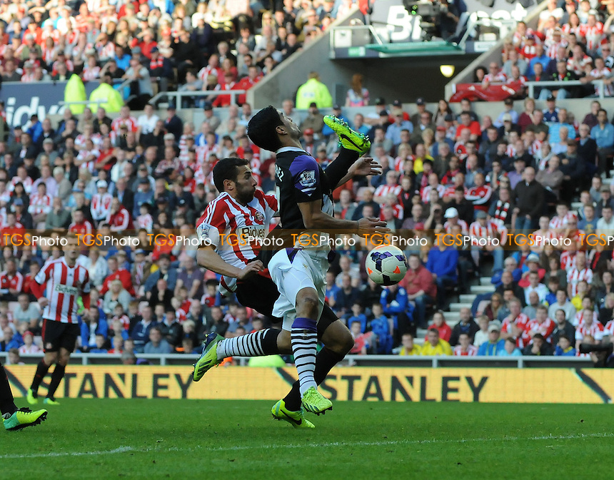 Luis Su&aacute;rez of Liverpool battles with Carlos Cu&eacute;llar of Sunderland - Sunderland vs Liverpool - Barclays Premier League Football at the Stadium of Light, Sunderland - 29/09/13 - MANDATORY CREDIT: Steven White/TGSPHOTO - Self billing applies where appropriate - 0845 094 6026 - contact@tgsphoto.co.uk - NO UNPAID USE<br />   i