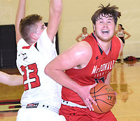RICK PECK/SPECIAL TO MCDONALD COUNTY PRESS<br /> McDonald County's 6-5 forward Cooper Reece powers past Aurora's Kaden Clark for two of his team-high 15 points in the Mustangs' 48-39 win on Jan. 4 at Aurora High School.