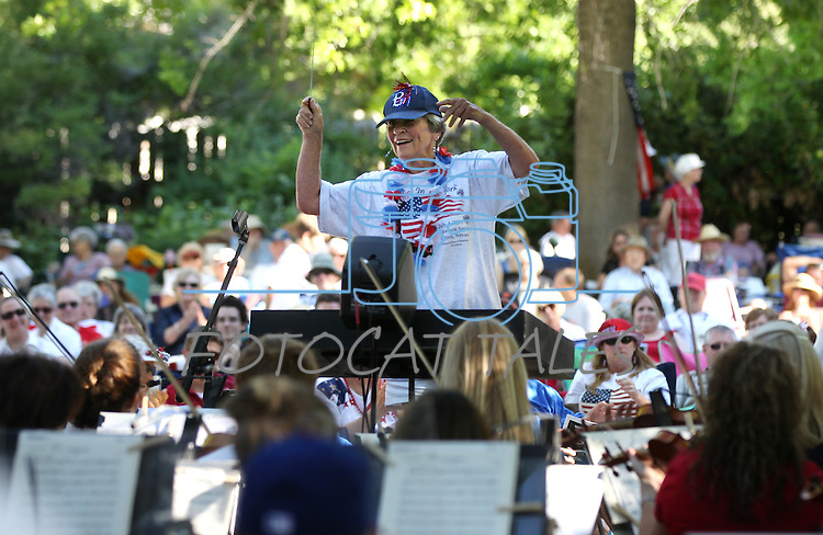 A raffle winner from the crowd gets to conduct the Reno Philharmonic Orchestra during the Pops in the Park concert at the Mormon Station State Park in Genoa, Nev., on Monday, July 4, 2011..Photo by Cathleen Allison