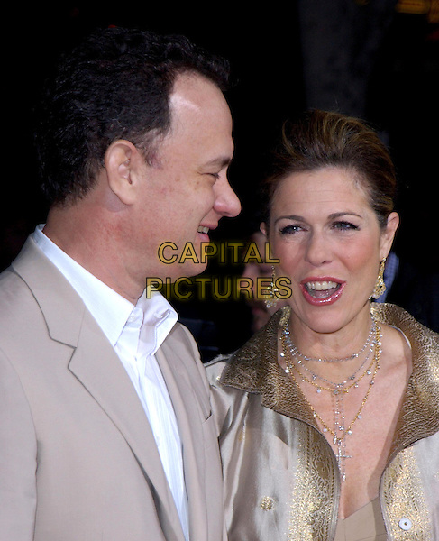 TOM HANKS & WIFE RITA WILSON.Los Angeles Premiere of The LadyKillers held at The El Capitan Theatre in Hollywood, California .12 March 2004.*UK Sales Only*.www.capitalpictures.com.sales@capitalpictures.com.©Capital Pictures.