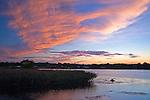 Colorful Sunlight Illuminating Clouds at Dusk over Harbor on the Island of Kökar