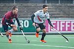 AMSTELVEEN - Tanguy Cosyns (Adam) met Blake Wotherspoon (HCKZ) tijdens de hoofdklasse competitiewedstrijd mannen, Amsterdam-HCKC (1-0).  COPYRIGHT KOEN SUYK