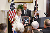 United States President Barack Obama presents the Medal of Honor posthumously to Army First Lieutenant Alonzo H. Cushing for conspicuous gallantry to his descendent Helen Loring Ensign in the Roosevelt Room of the White House, November 6, 2014 in Washington, DC. First Lieutenant Cushing received the Medal of Honor for his actions during combat operations in the vicinity of Cemetery Ridge, Gettysburg, Pennsylvania, on July 3, 1863.<br /> Credit: Olivier Douliery / Pool via CNP