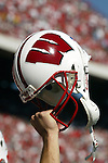 Madison, Wisconsin - 9/20/03. A University of Wisconsin player raises his helmet during the North Carolina game at Camp Randall Stadium. Wisconsin beat North Carolina 38-27. (Photo by David Stluka)