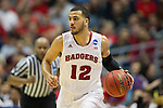 Wisconsin Badgers guard Traevon Jackson (12) handles the ball during  a regional semifinal NCAA college basketball tournament game against the Baylor Bears Thursday, March 27, 2014 in Anaheim, California. The Badgers won 69-52. (Photo by David Stluka)