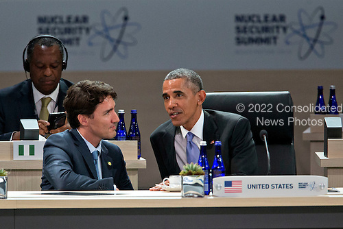 United States President Barack Obama, right, talks to Justin Trudeau, Canada's prime minister, during a closing session at the Nuclear Security Summit in Washington, D.C., U.S., on Friday, April 1, 2016. After a spate of terrorist attacks from Europe to Africa, Obama is rallying international support during the summit for an effort to keep Islamic State and similar groups from obtaining nuclear material and other weapons of mass destruction. <br /> Credit: Andrew Harrer / Pool via CNP