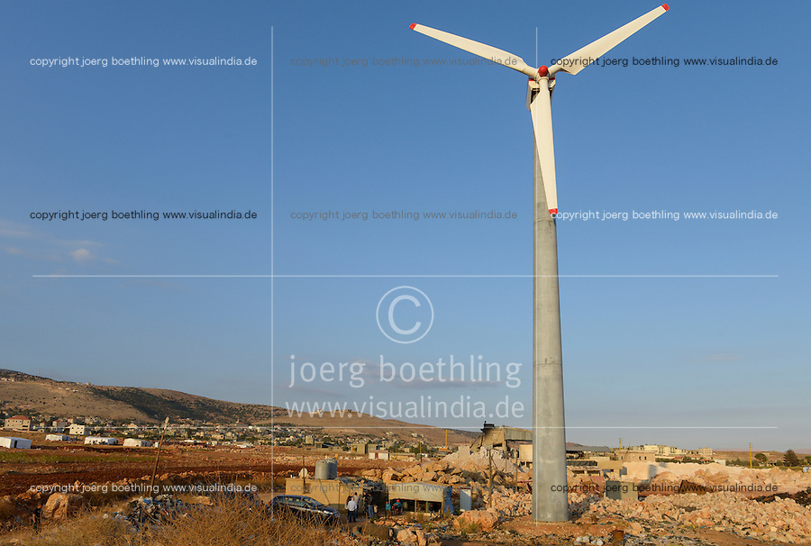LEBANON Deir el Ahmar, camp for syrian refugees in the Beqaa valley, wind turbine / LIBANON Bekaa Tal, Deir el Ahmar, Camp fuer syrische Fluechtlinge am Dorfrand, Windkraftanlage